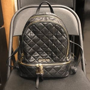 Black and gold Micheal Kors back pack